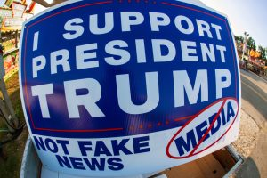 "A sign that reads, ""I support President Trump. Not fake news media."""