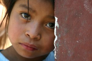 A close-up photo of a young Hispanic girl.