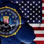 The American flag juxtaposed against the FBI flag.