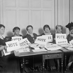 "National League of Women Voters hold up signs reading, ""VOTE."" Sept. 17, 1924."