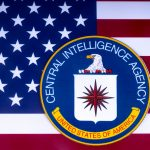 The CIA seal juxtaposed against the American flag.