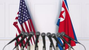 The American flag and the North Korean flag shown side-by-side.