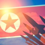 The North Korean flag shown with missiles on it.