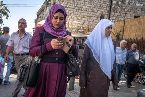 Palestinian people pass by the Damascus Gate and nearby market area in East Jerusalem.