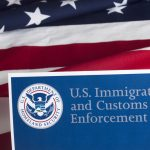 "A document labeled ""U.S. Immigration and Customs Enforcement"" juxtaposed against an American flag background."