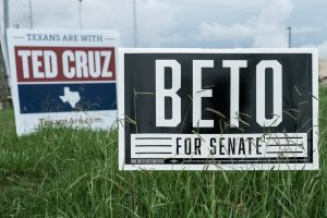 Campaign signs for Democrat Beto O'Rourke and Republican incumbent Ted Cruz, who are running against each other in the Texas U.S. Senate race.