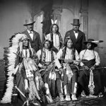 A historic black-and-white photo of Native Americans.